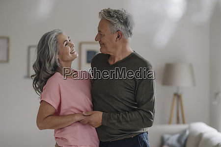 happy senior couple in living room