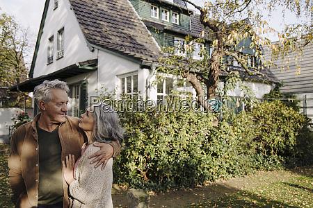 senior couple in garden of their