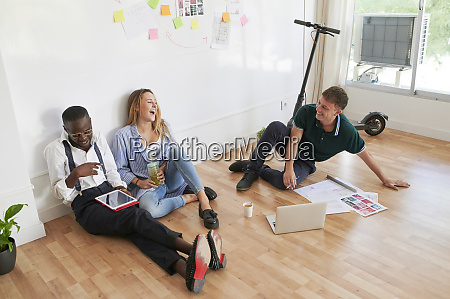 happy young business people sitting together