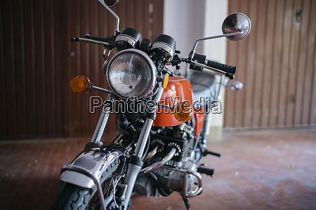 vintage motorbike parked in garage