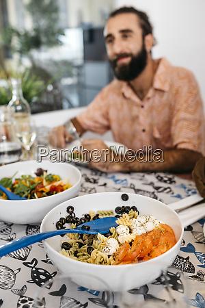 smiling man sitting at dining table
