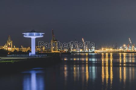 illuminated lighthouse zero by elbe river