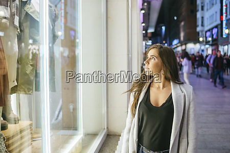 woman looking at shop window in