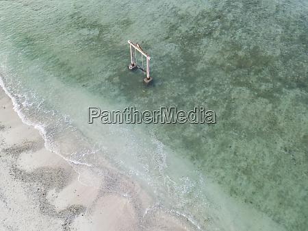 drone shot of swings in gili