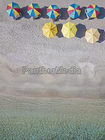 drone shot of colorful parasols arranged