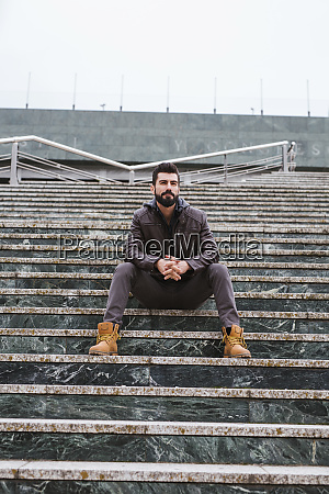 portrait of bearded man sitting on