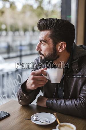 bearded mature man in a coffee