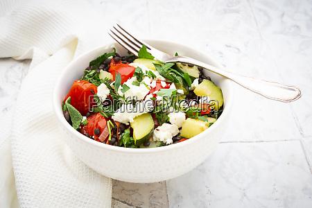 bowl of salad with beluga lentils