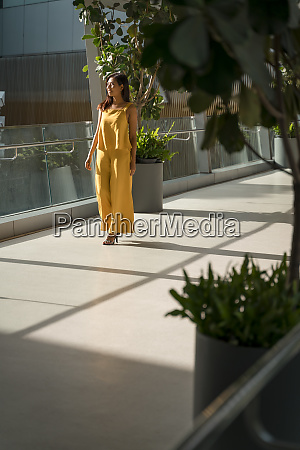 fashionable woman dressed in yellow on