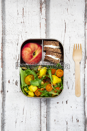 close up of lunchbox with mango
