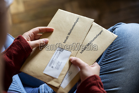 female elector holding documtents for the