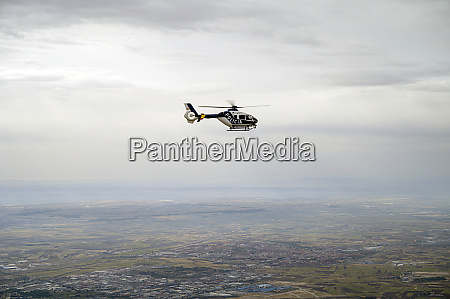 spain madrid police helicopter flying above
