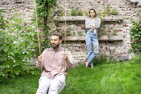 couple in backyard man sitting on