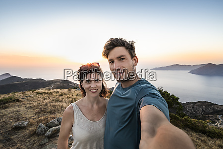 couple taking a selfie at sunset