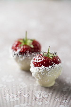 close up of strawberries with white