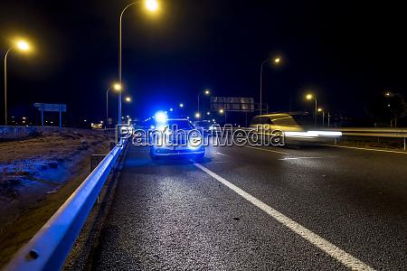 illuminated police car on road of
