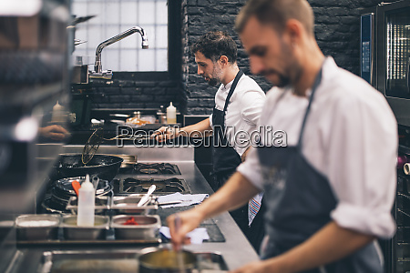 two cooks at work in a
