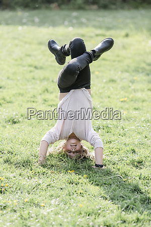 girl doing a headstand on a