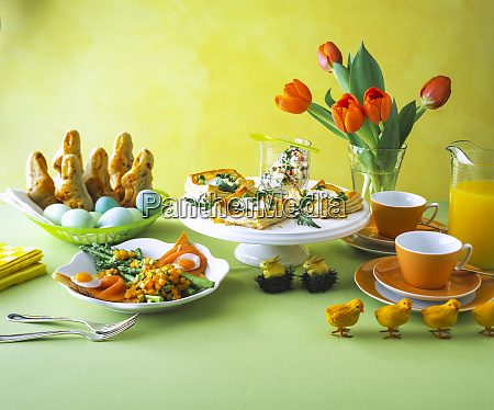 food arranged on table against yellow
