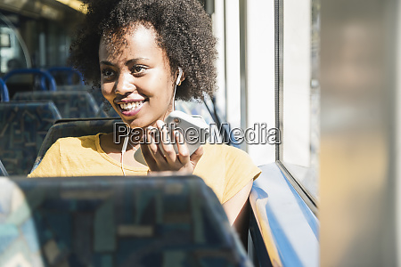 happy young woman with earphones and