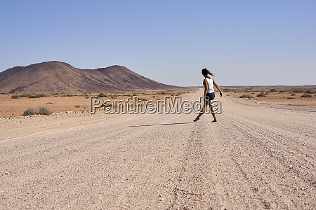 woman walking in the middle of