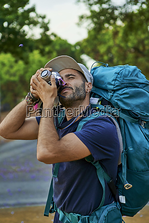 backpacker taking a picture