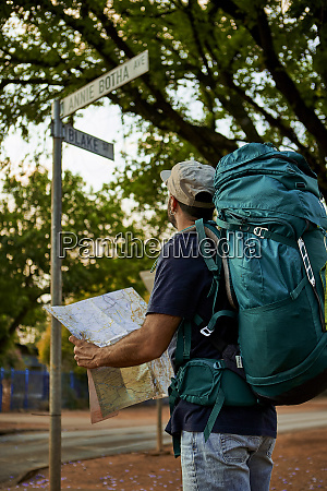 backpacker checking the name of a