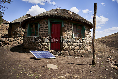 traditional house with a solar panel