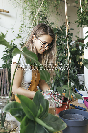 young woman working with soil in