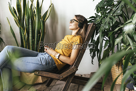 relaxed young womansitting in chair listening