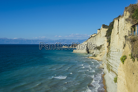scenic view of cliff by sea
