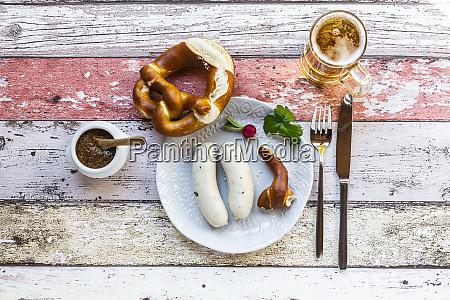 white sausage breakfast with pretzels mustard