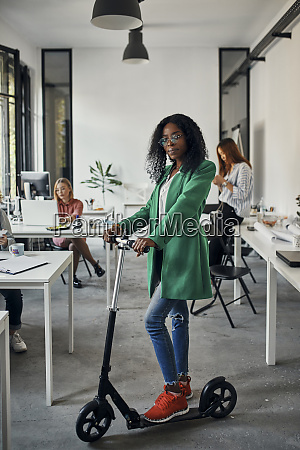 portrait of a businesswoman with kick