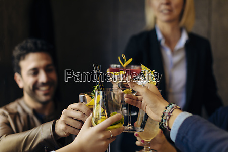 colleagues toasting with cocktails in a