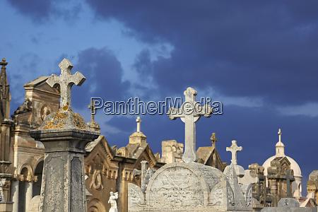 italy sicily alcamo gravestones against moody