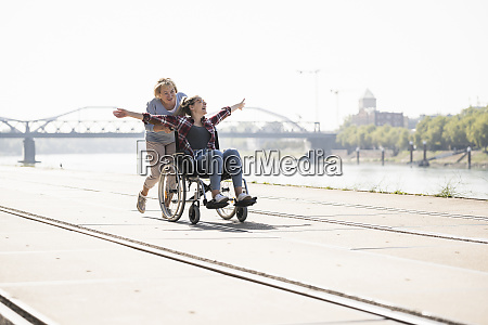 grandmother with her granddaughter sitting in
