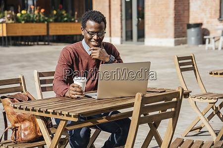 young man using laptop in a