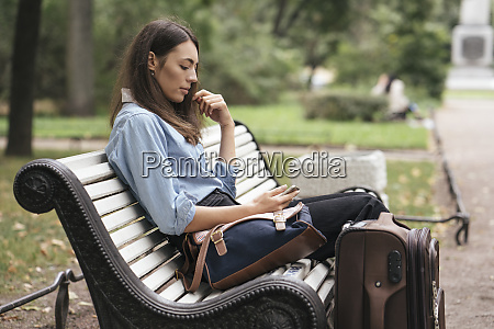 young female traveller at station