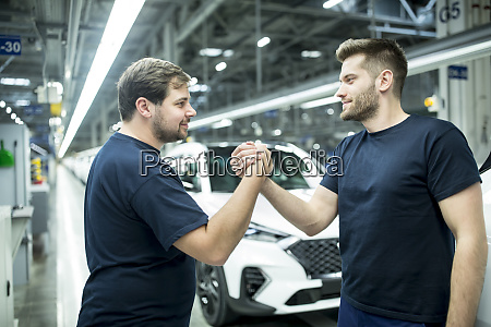 two colleagues shaking hands in modern