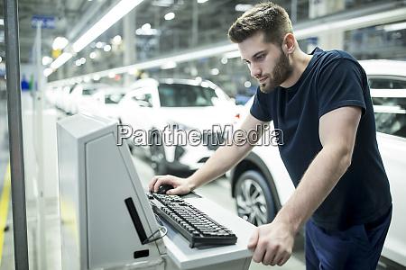 man working on computer in modern