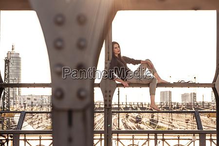 young woman sitting on hacker bridge