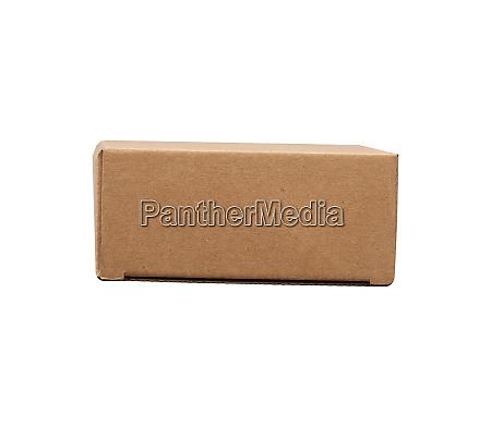 closed brown rectangular cardboard box for