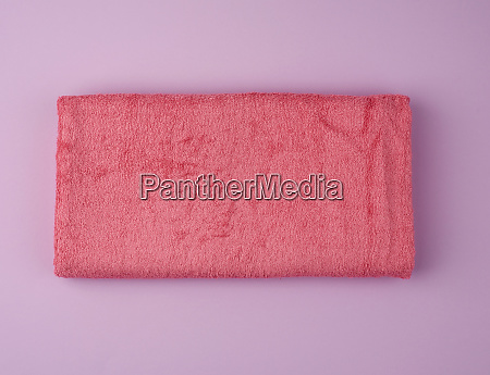 folded bath terry pink towel on
