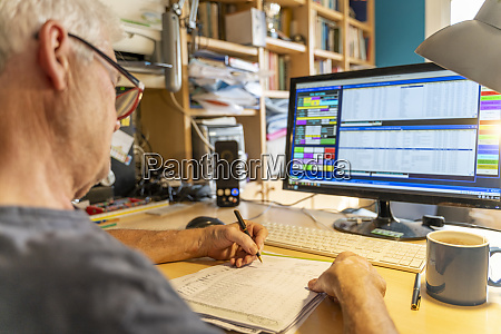 senior man working in office using