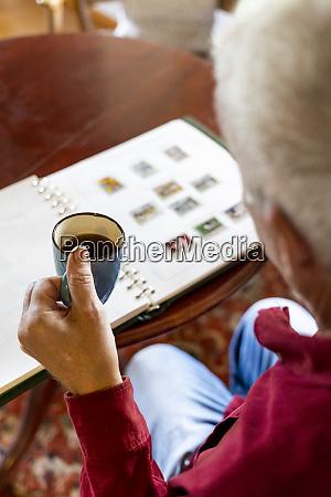 senior man looking at home at