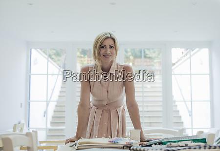 portrait of female entrepreneur standing near