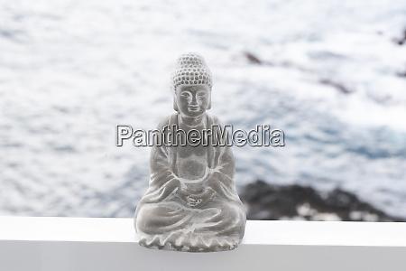 concrete buddha figure ocean in the