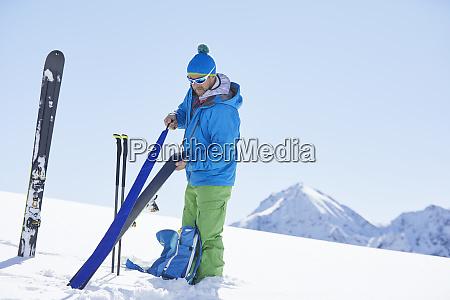 ski tourer attaching pelt to ski