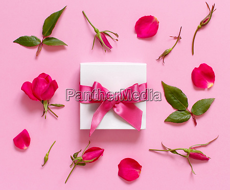 white gift box and flowers on