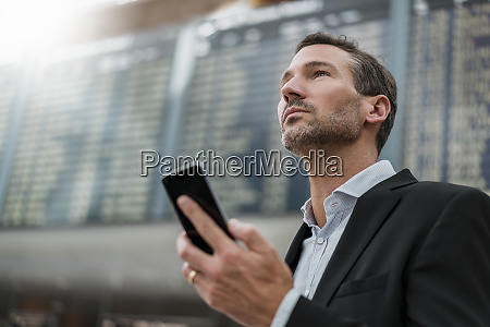 portrait of businessman with cell phone